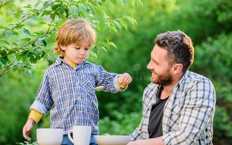 Little boy and dad eat. Organic nutrition. Healthy nutrition concept. Nutrition habits. Family enjoy homemade meal stock image
