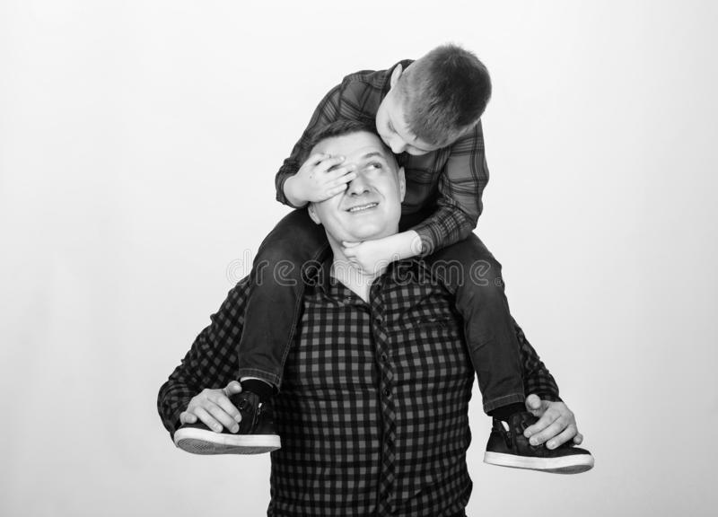 Little boy with dad man. father and son in red checkered shirt. childhood. parenting. fathers day. happy family. Fits. Perfect. Lost in his fairytale. Moments stock photos