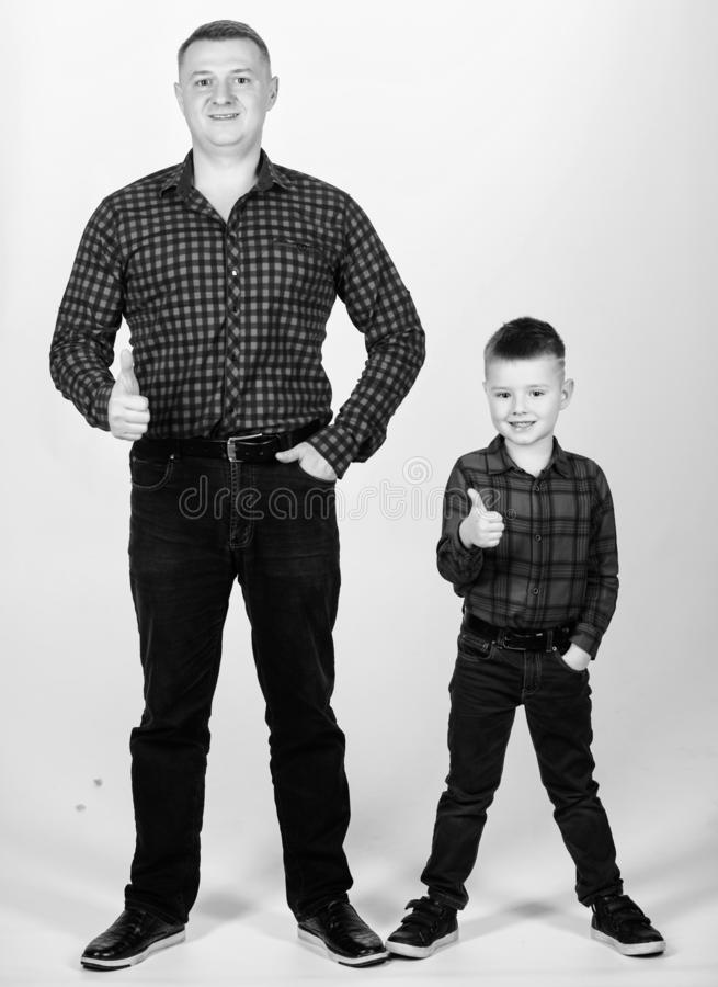 Little boy with dad man. fathers day. happy family. childhood. parenting. father and son in red checkered shirt. Country. Style. success. thumb up gesture stock image