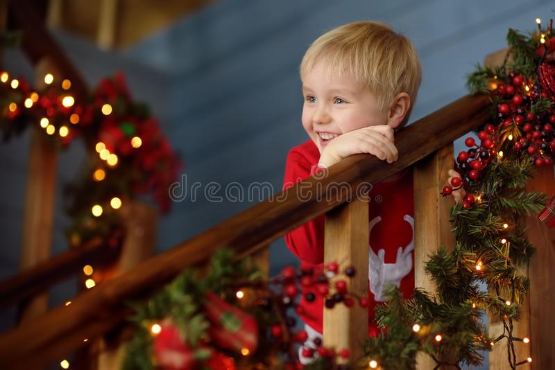 Little boy in decorated christmas house interior stock images