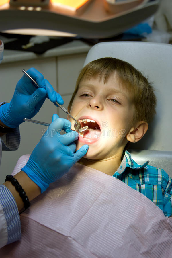 Little boy with a doctor in dental surgery stock photography