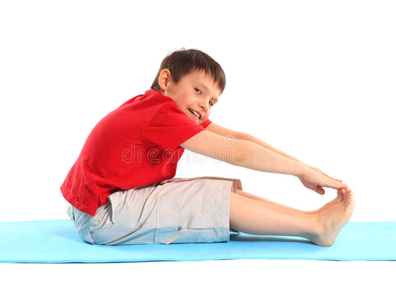 The little boy does exercise. royalty free stock photo