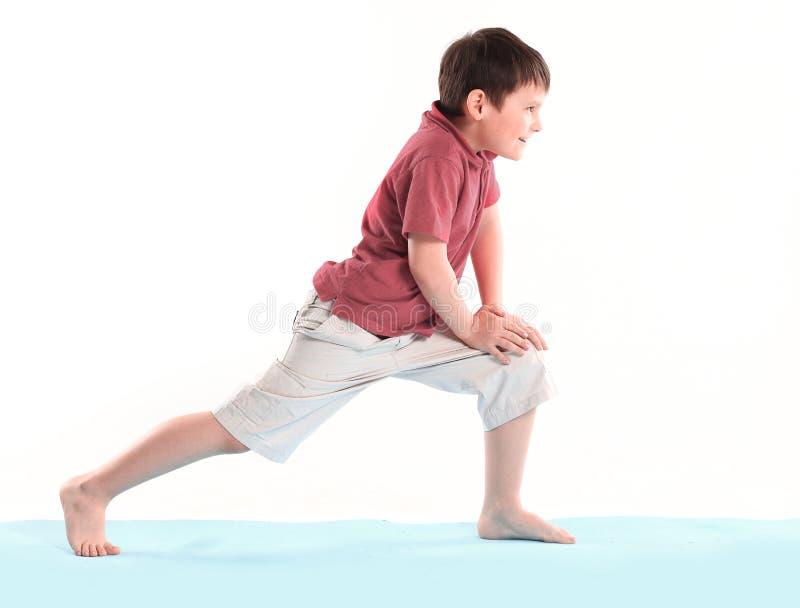 Little boy does morning exercises.isolated on white background royalty free stock photography