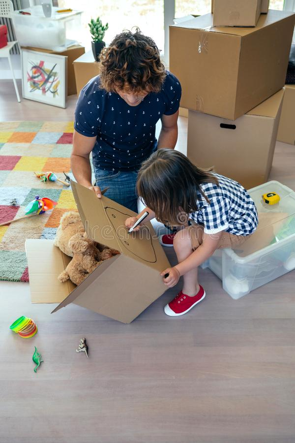 Boy drawing in a moving box royalty free stock image