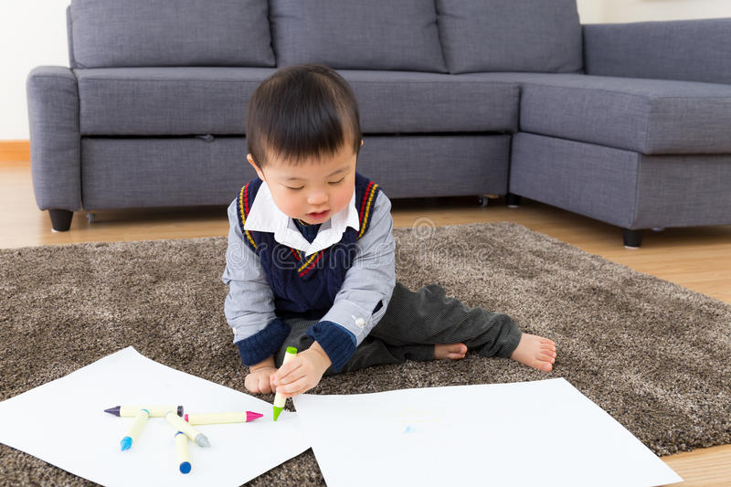 Little boy drawing picture stock photos