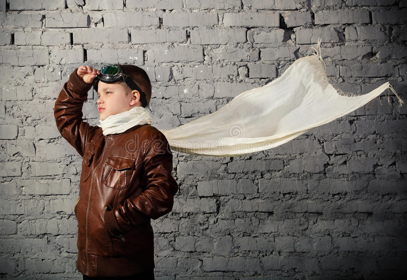 Little boy dreaming of becoming a pilot. In retro style uniform stock photography