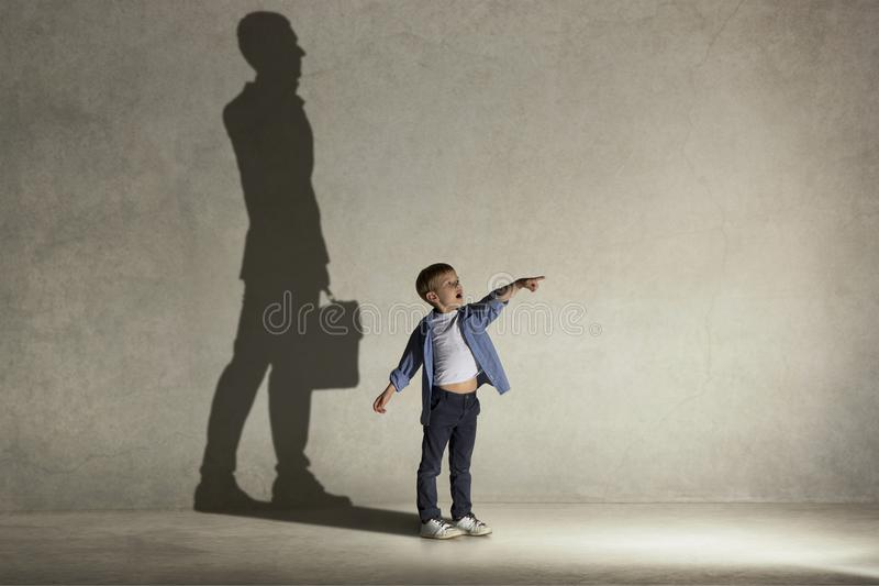 The little boy dreaming about businessman profession stock photo