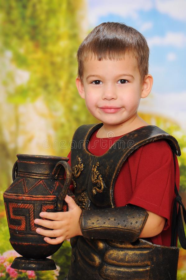 Little boy dressed as a Roman soldier stock images