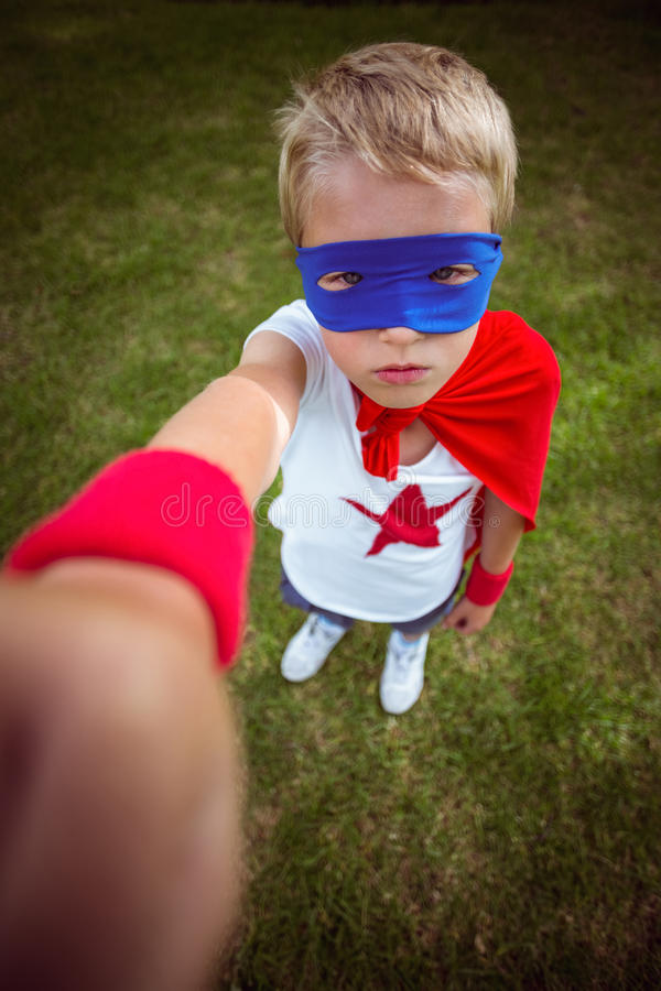 Little boy dressed as superman. In the garden stock images