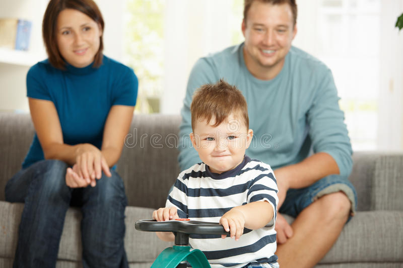 Little boy driving toy car royalty free stock image
