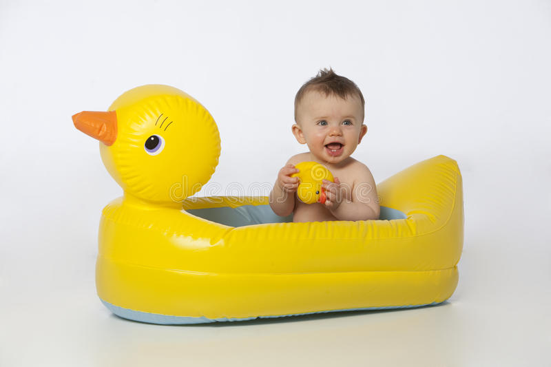 Little boy in duck tub royalty free stock image