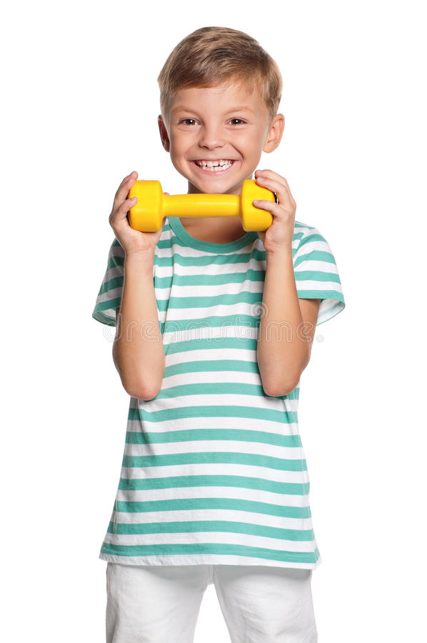 Download Little boy with dumbbells stock photo. Image of health - 27284010