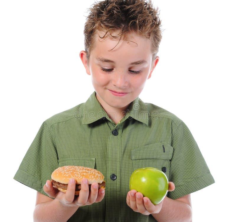 Free Little Boy Eating A Hamburger Stock Photography - 20017352