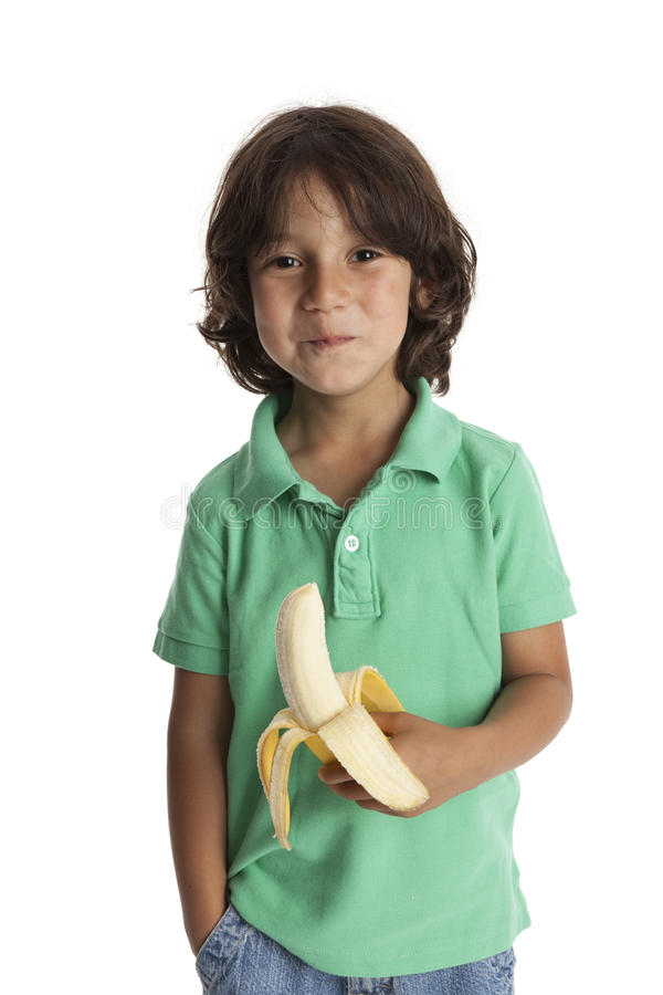 Download Little boy eating a banana stock image. Image of years - 15197899