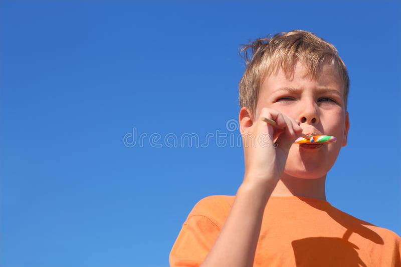 Little Boy Eating Multicolored Lollipop Royalty Free Stock Photos
