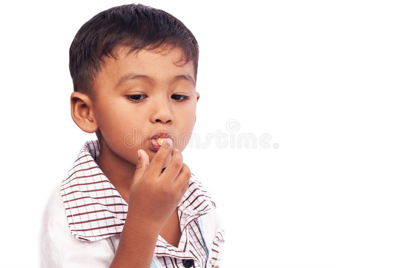 Little boy eating snack food stock photos