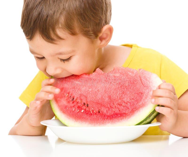 Little boy is eating watermelon. Cute little boy is eating watermelon, isolated over white stock photography
