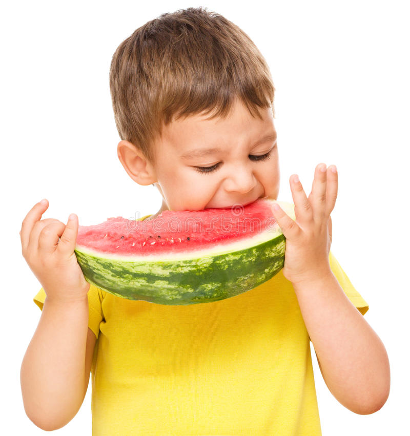 Little boy is eating watermelon. Cute little boy is eating watermelon, isolated over white royalty free stock image