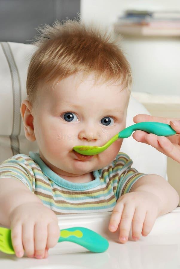 The little boy eats stock images