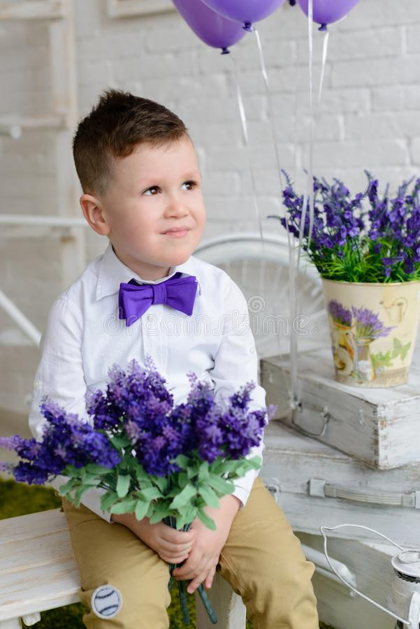 Little boy in elegant clothes. It can be used as a background. Little boy in elegant clothes. Provence style. It can be used as a background stock images