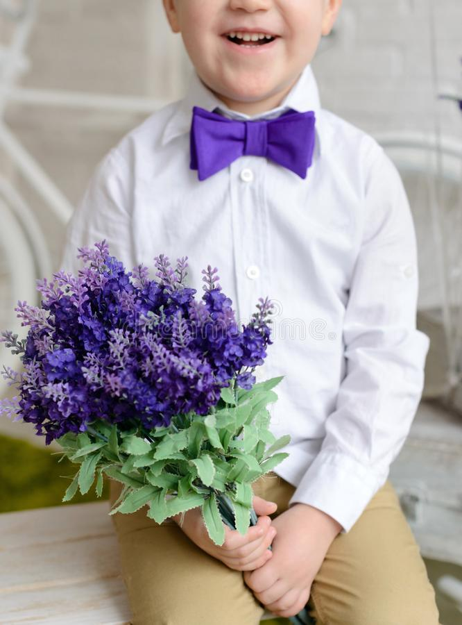 Little boy in elegant clothes. It can be used as a background. Little boy in elegant clothes. Provence style. It can be used as a background stock photos