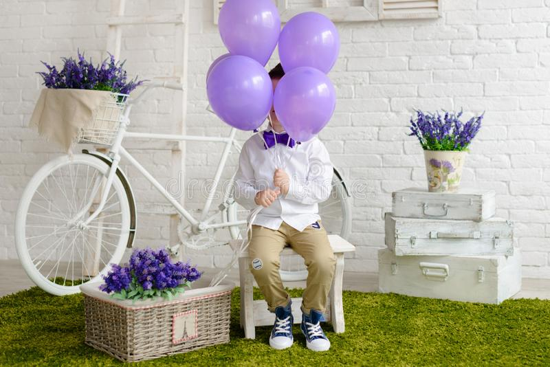 Little boy in elegant clothes. It can be used as a background. Little boy in elegant clothes. Provence style. It can be used as a background stock photo