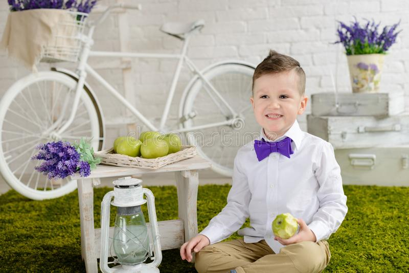 Little boy in elegant clothes. It can be used as a background. Little boy in elegant clothes. Provence style. It can be used as a background stock photography