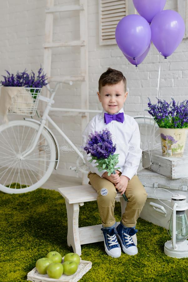 Little boy in elegant clothes. It can be used as a background. Little boy in elegant clothes. Provence style. It can be used as a background royalty free stock image
