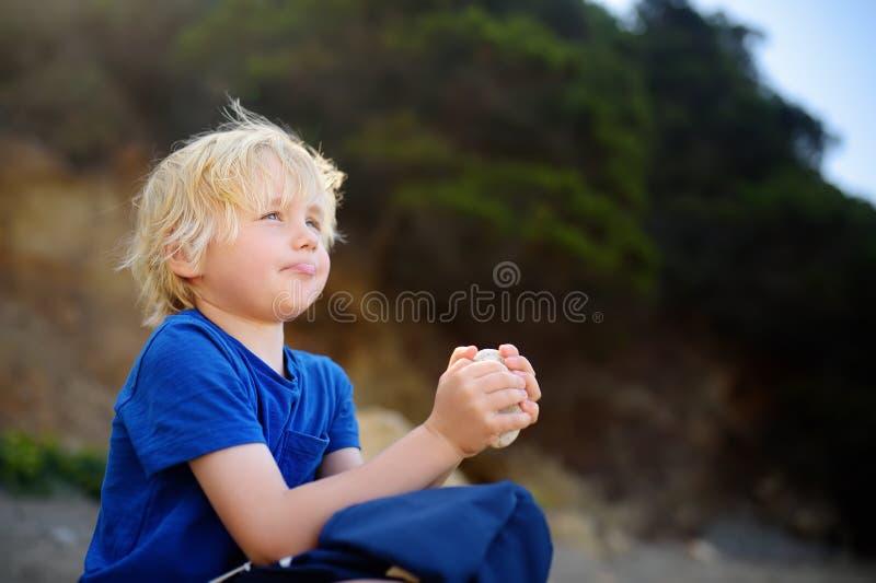 Little boy enjoy amazing sky during walking royalty free stock photography