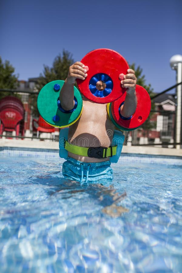 Little boy enjoy the pool royalty free stock images