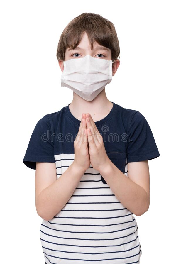Little boy with face mask praying royalty free stock photo