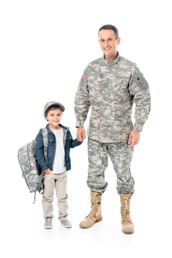 little boy and father in military uniform holding hands together stock photography