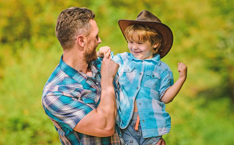 Little boy and father in nature background. Spirit of adventures. Strong like father. Power being father. Child having stock photos