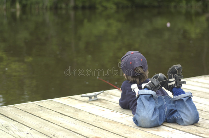 Little boy fishing royalty free stock images
