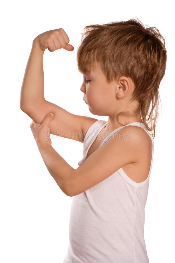 Little boy flexing biceps. Portrait of little european boy flexing biceps. Beautiful caucasian model. Isolated on white background stock images