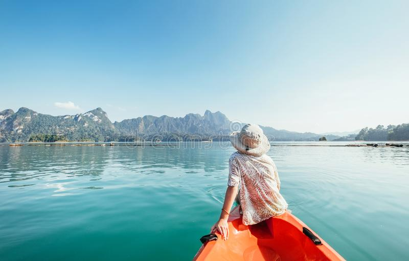 Little boy floating on kayak on Cheow Lan Lake, Khao Sok national park, Thailand royalty free stock photos