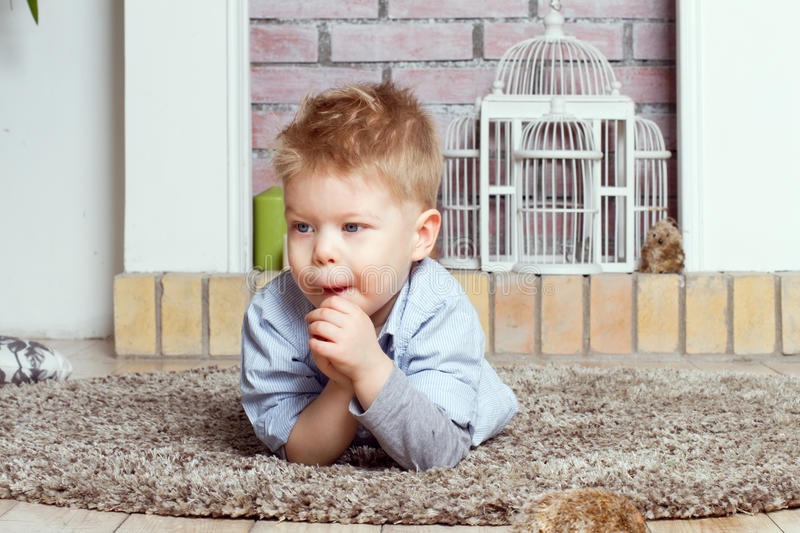 Download Little boy on a floor stock image. Image of alone, pretty - 25050249