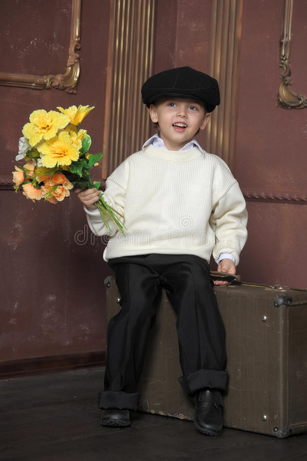 Download Little Boy With Flowers Royalty Free Stock Image - Image: 25186456