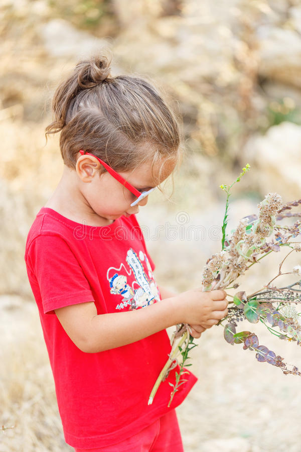 Download Little boy with flowers stock photo. Image of love, gift - 83720638