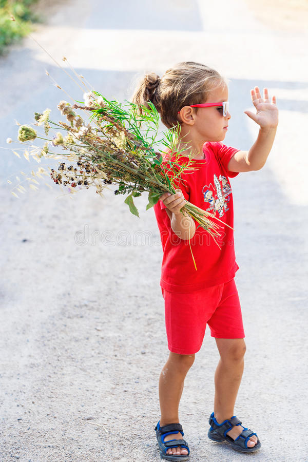 Download Little Boy With Flowers Stock Photo - Image: 83721148