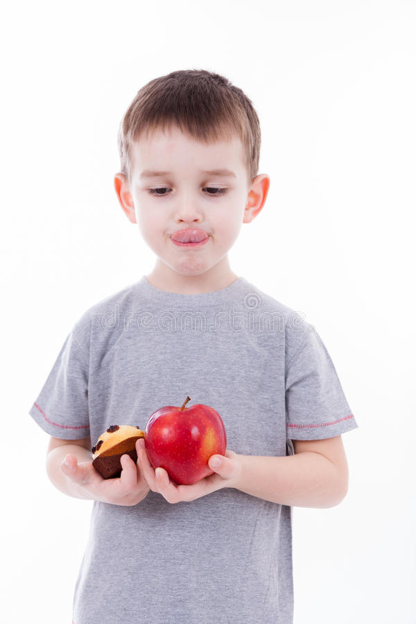 Little boy with food isolated on white background - apple or a m royalty free stock images