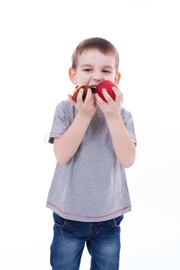 Little boy with food isolated on white background - apple or a m royalty free stock photo