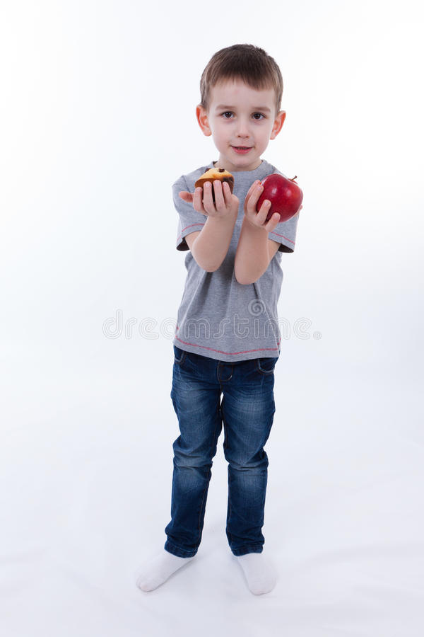 Little boy with food isolated on white background - apple or a m stock photo
