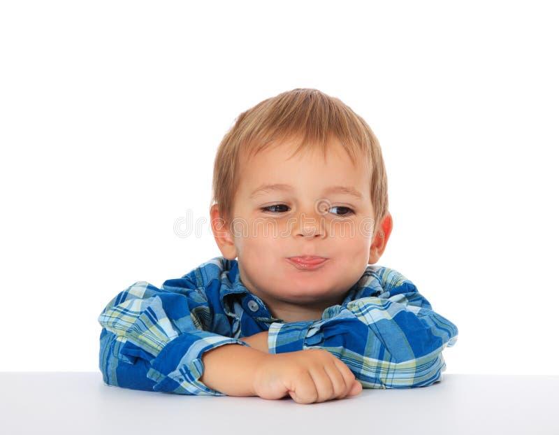 Little boy fooling around stock image