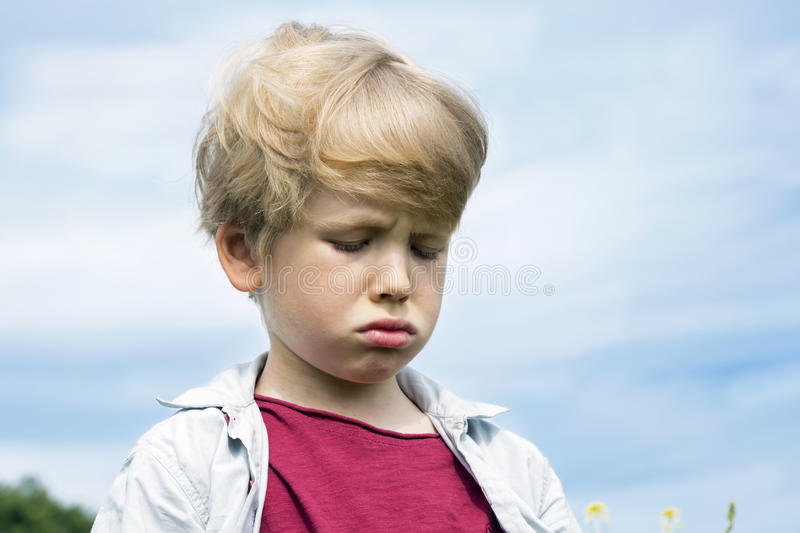 Little Boy Frowning Sad Cry royalty free stock photo