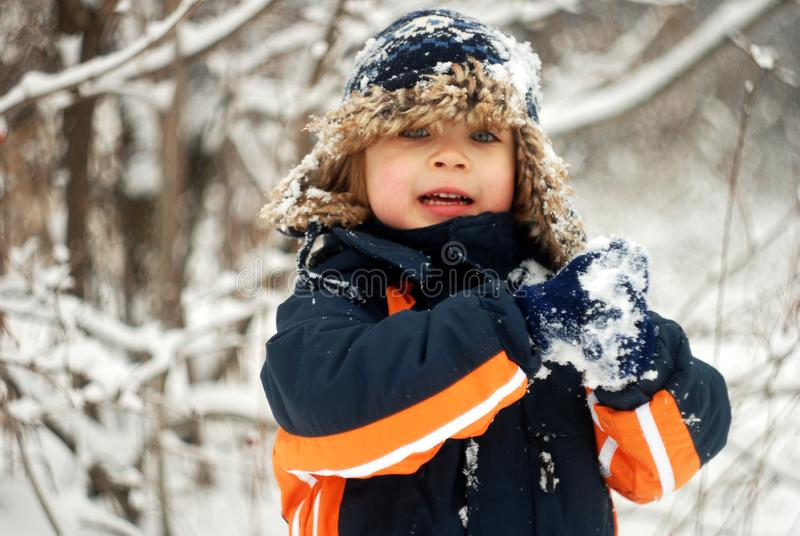 Little Boy Playing In The Snow royalty free stock photo