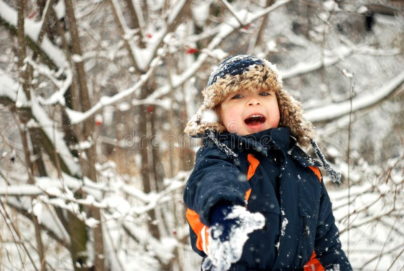 Little Boy Playing In The Snow stock photography