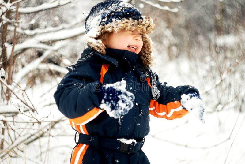 Little Boy Playing In The Snow royalty free stock photography