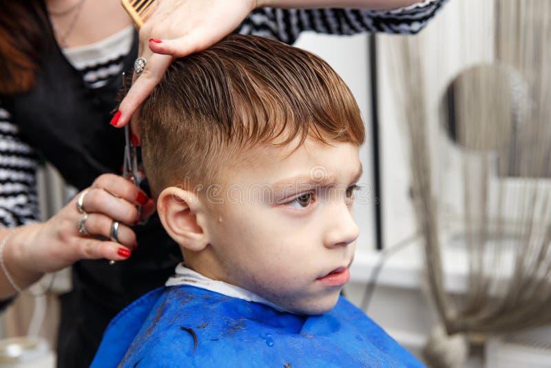 Little boy getting haircut royalty free stock photo