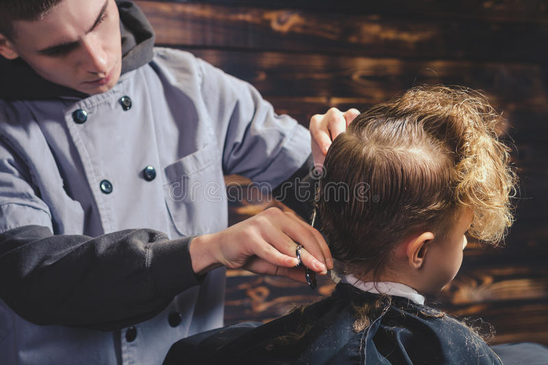 Download Little Boy Getting Haircut By Barber Stock Photo - Image: 83705586